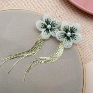 arete daisy nurhia accesorios